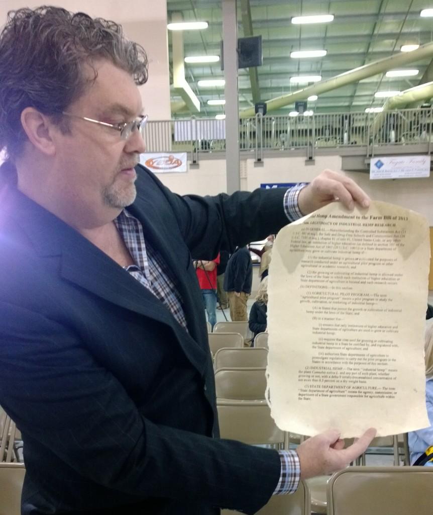 Eric Steenstra, President of Vote Hemp with a copy of the hemp amendment printed on 100% hemp paper.